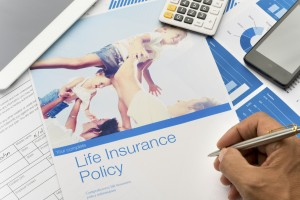 Life insurance brochure with family image and paperwork. The included image can be found in my portfolio. Image  #37803180